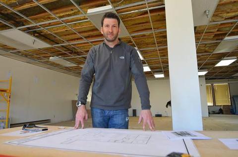 Aaron-Landau-posing-with-siteplans